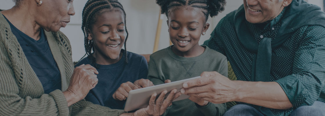 African American family using smart home app